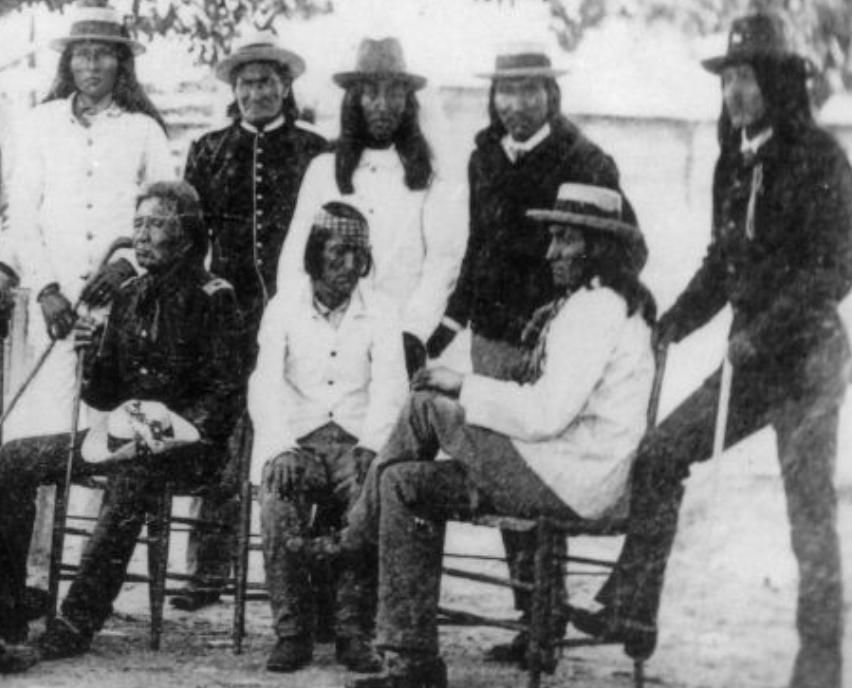 Geronimo(2nd from left,standing) and fellow Apaches as captives of U.S. Government-Mt Vernon Barracks-early 1890's